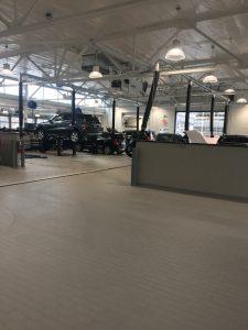 car mechanic garage and workroom overhead industrial wiring and lighting